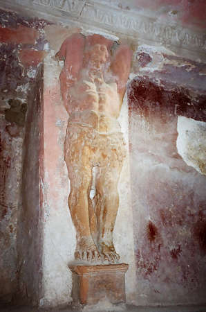 Statue on the wall of Pompeii, Italy