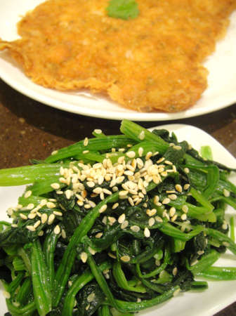 Spinach with toasted sesame seeds                        Stock Photo