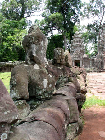 Guardianas along the gate to Preah Khan at Angkor, Cambodia