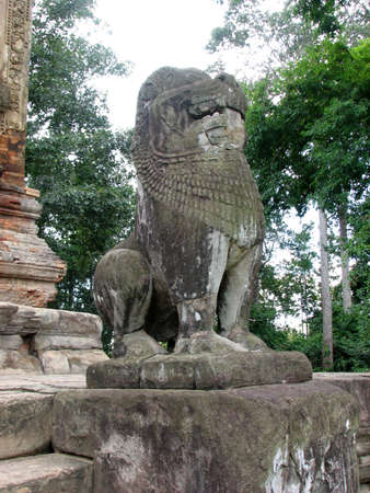 A statue of a lion guards at Preah Ko of Roluos Group, Angkor, Cambodia  photo