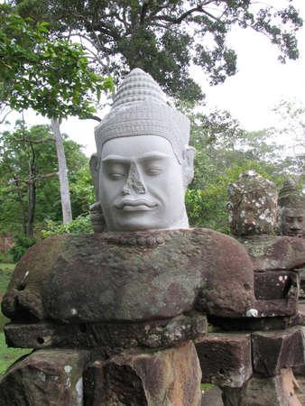 Stone guardian faces at South Gate of Angkor Thom, Angkor, Cambodia Stock Photo - 7972963