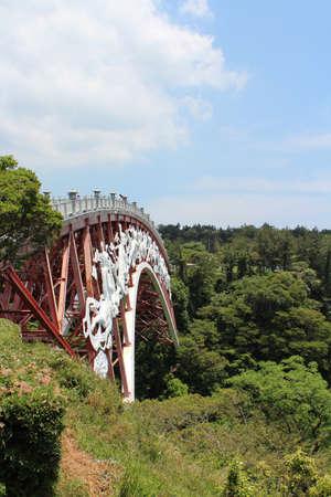 Seonimgyo bridge at Cheonjeyeon Waterfalls in Jeju Island, South Korea Stock Photo