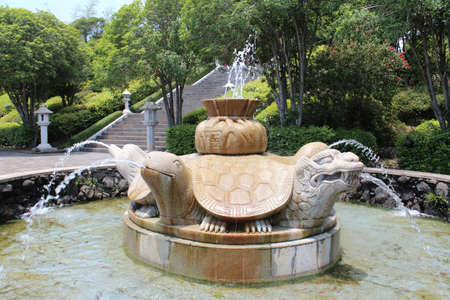 Fountain of Five Blessings at Cheonjeyeon Waterfalls in Jeju Island, South Korea Stock Photo