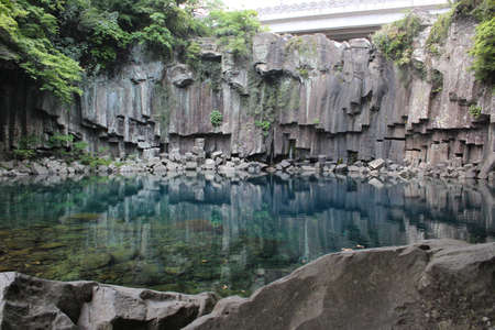 Cheonjeyeon Waterfalls in Jeju Island, South Korea photo