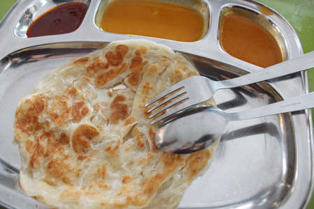 Roti canai or roti cane is a type of Indian-influenced flatbread in Malaysia