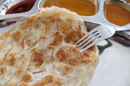 Roti canai or roti cane is a type of Indian-influenced flatbread in Malaysia