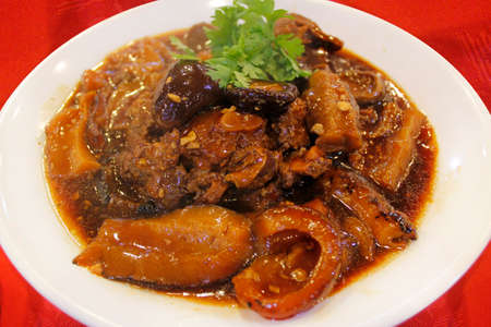 sea cucumber: Braised sea cucumber with pork trotters and mushrooms in soy sauce Stock Photo
