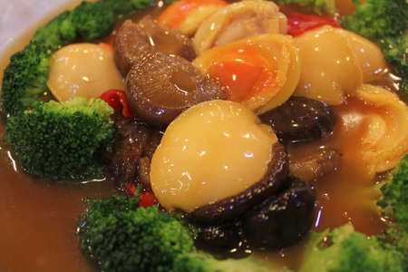 Braised abalone with mushrooms, broccoli and bell pepper in gravy sauce