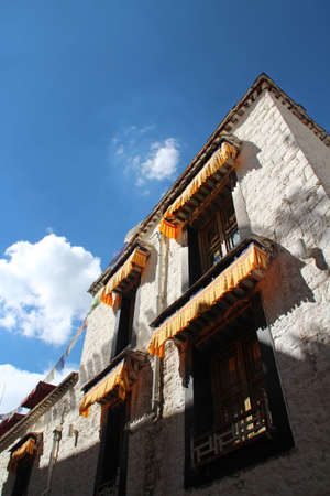 tibetan house: Tibetan house with the blue sky and white clouds in Lhasa, Tibet, China