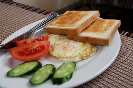 english cucumber: English breakfast with bread, egg, tomato and cucumber in Lhasa, Tibet, China