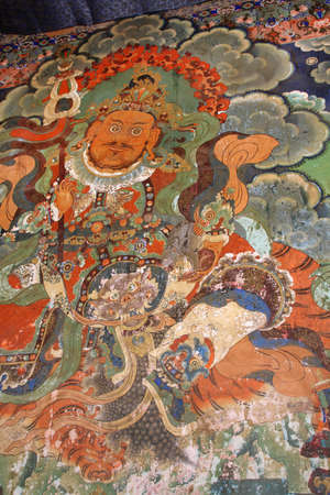 Y?lkhorsung, Heavenly King of the North (yellow) painted on the wall of the Sera Monastery in Lhasa, Tibet, China Editorial