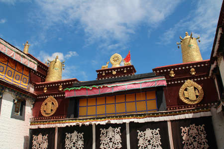 Gilded deers with dharmacakra and bells on the top of roof at Jokhang Temple in Lhasa, Tibet, China photo