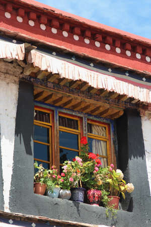 Window with the flowers at the Jokhang Temple in Lhasa, Tibet, China photo