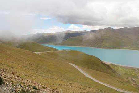 Yamdrok Lake in foggy day, Tibet, China