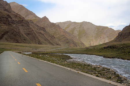 Road running through mountains in Tibet, China photo