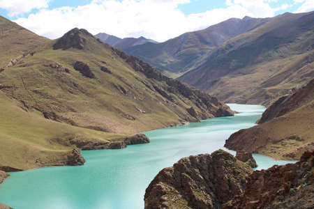 Scenery of translucent green colour of Manla Reservoir in Gyantse, Tibet, China Stock Photo