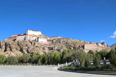 View of Gyantse Dzong, also known Gyangze Castle built on a huge spur of grey brown rock in Tibet, China