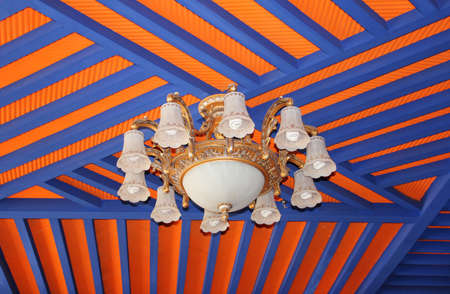 architectural lighting design: Chandelier with the blue and orange beams in Tibet, China