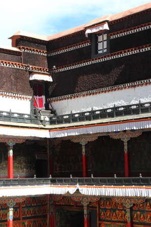 Tibetan building with window and columns in the Tashilhunpo monastery, Shigatse, Tibet