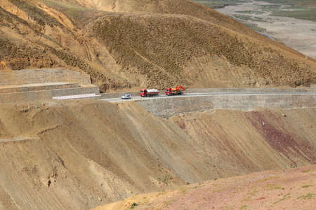 Car and trucks on the China National Highway 318 (G318) running through mountains in Tibet, China Stock Photo