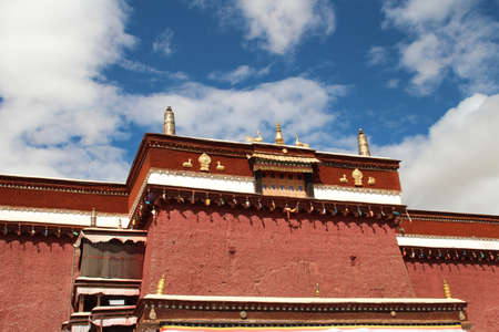 Red wall with the gilded roof in Sakya Monastery, Tibet, China