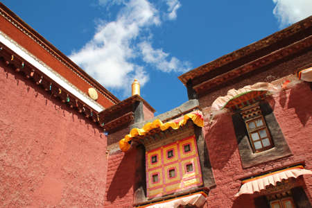 Red wall with the windows in Sakya Monastery, Tibet, China photo
