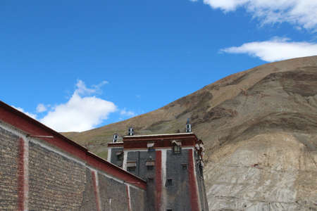Red and grey wall with the windows in Sakya Monastery, Tibet, China photo