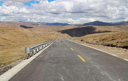 non marking: Road running through mountains in Tibet, China