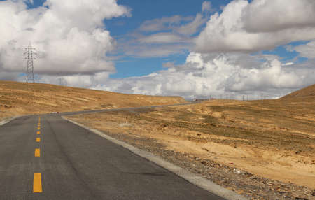 Road running through mountains in Tibet, China