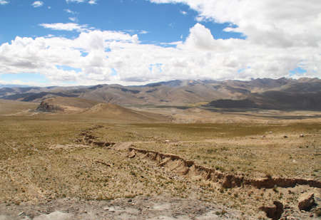 View of the mountains with dramatic sky in Tibet, China Stock Photo