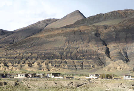 View of the mountain and Tibetan village near Tingri on the way to Everest Base Camp, Tibet, China