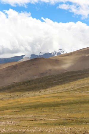View of the mountains and dramatic sky on the way to Everest Base Camp, Tibet, China
