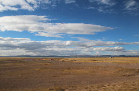 View of mountains, grassland, Nomadic tents with the dramatic sky near Namtso in Tibet, China