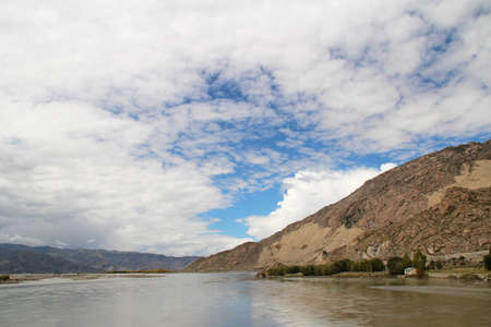 View of mountains and Yarlung Tsangpo river with the dramatic sky in Lhasa Tibet