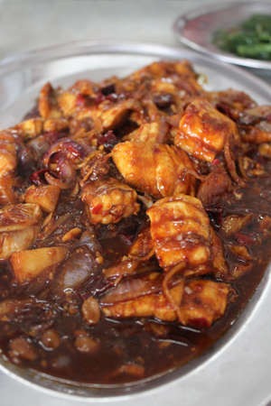 fermenting: Stirfried shark meat with fermented black soybeans chilli ginger and onions in the restaurant of Malaysia