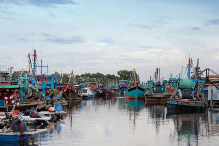 Fishing boats along the river at Bagan Sekinchan Kuala Selangor Malaysia