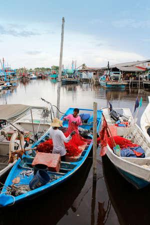 fishermans net: The fishermans are tidy up the fishing net in Fishing Village Sekinchan.