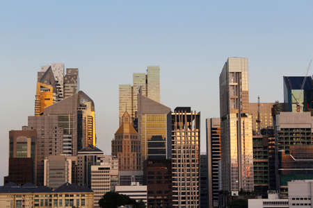 southeast asian ethnicity: View of the Singapore financial district and skyscrapers from Chinatown in sunset