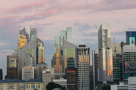 View of the Singapore financial district and skyscrapers from Chinatown in sunset