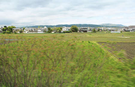 View of a rural town with the paddy fields along the way to Nara, Japan