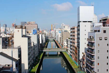 Morning view of Osaka with the Dotonbori Canal and the blue sky.