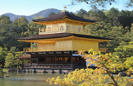 rokuonji: Kinkaku-ji, officially named is Rokuon-ji during the sunset with surrounding by the pond, trees and mountain in Kyoto, Japan