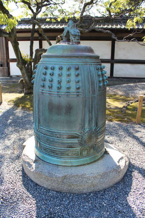 Antique bronze bell at Ninomaru Palace at the Nijō Castle with the dragon statue on top in Kyoto, Japan