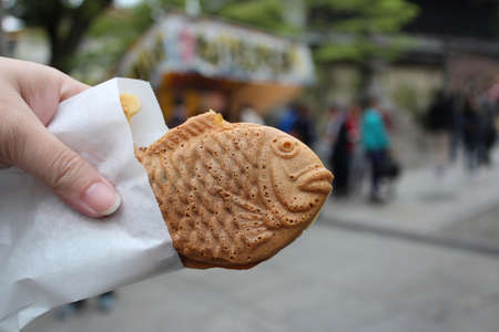 Taiyaki is fish-shaped pancake stuffed with sweetened red bean paste as a common street snack in Japan