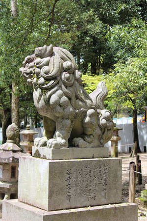 Lion guardian statue at Kasuga Shrine with sunny day in spring, Nara, Japan