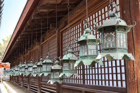 Row of ornate bronze lanterns as the famous point of Kasuga Grand Shrine in Nara, Japan