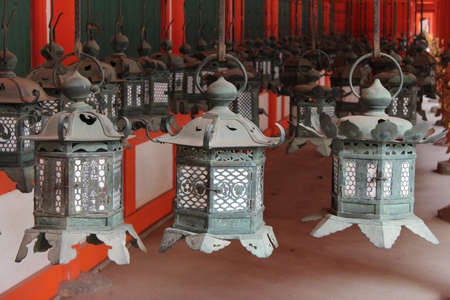 Detail of a row of ornate bronze lanterns as the famous point of shrine in Nara, Japan
