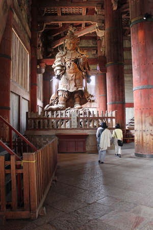 Komokuten, one of four celestial guardians of four directions is King of the West, Lord of Limitless Vision. Visitors are small when walk through this huge statue at Todaiji Temple, Nara