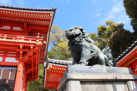 Statue of lion-dog called Komainu at the main gate as the guardian of Yasaka Shrine in Kyoto, Japan
