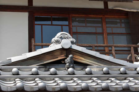 Japanese roof with statue of a house near the Kiyomizu-dera in Kyoto, Japan